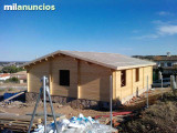 Montadores de boxes y casas de madera - foto