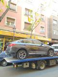 Grua porta coches en Madrid alrededor - foto