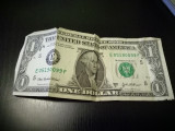 1 DOLAR
